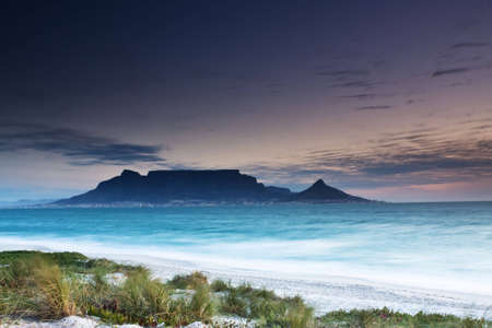 seascapes: Table Mountain from Milnerton beach with grass in the foreground