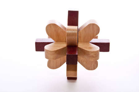 disassemble: Two colored wooden burr puzzle assembled on white Stock Photo