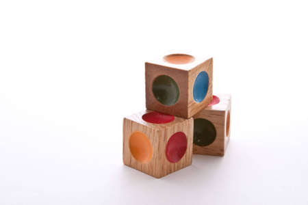 disassemble: Wooden blocks puzzle with indents of different colors Stock Photo