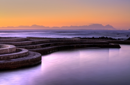 Gordons Bay tidal pool at sunset with Table Mountain as backdrop photo