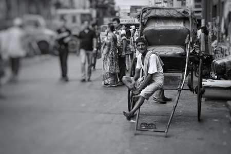 A hand rickshaw puller enjoying his break after a day of hard work