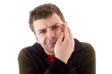 dent douleur: Les jeunes hommes dans la douleur dentaire. Studio de photographie.  Banque d'images