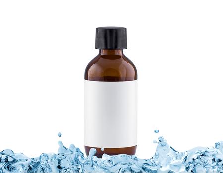 moisturiser: Brown cosmetic bottle with blank label in water splash, moisturiser concept, isolated on white