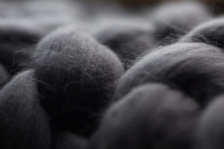 Close-up of knitted grey blanket, merino wool background Reklamní fotografie