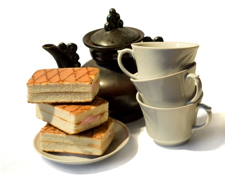 Cakes, kettle and three cups