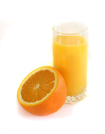 Half an orange and a glass of juice on a white background.  Stock Photo