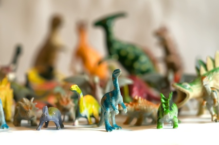 Dinosaurs toys, foreground and background blur.