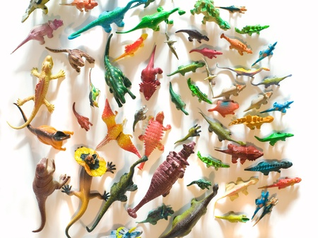 Dinosaurs toys, top view and white background.