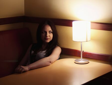 young beautiful girl in the room with lamp