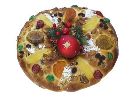 Traditional Portuguese Christmas cake, called Bolo Rei, with Christmas decoration in the centre