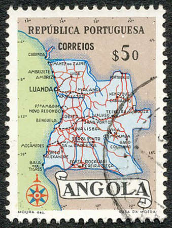ANGOLA – 1954: Stamp printed by the Portuguese administration showing the map of Angola photo