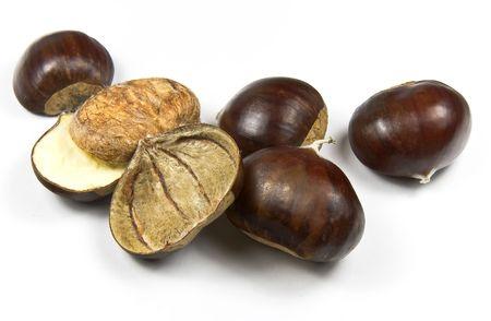 castanea sativa: Edible chestnuts (castanea sativa) isolated on white