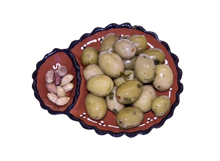 pits: Portuguese traditional ceramic olives bowl with a side pit's section.