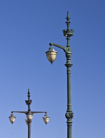 Antique street lamp against a blue sky Stock Photo