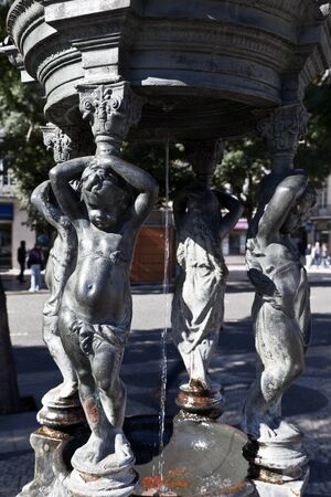 angels fountain: Fountain of the Little Angels is located in Rossio Square Editorial