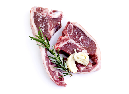 loin chops: Raw lamb loin chops with rosemary, garlic and salt isolated over white background