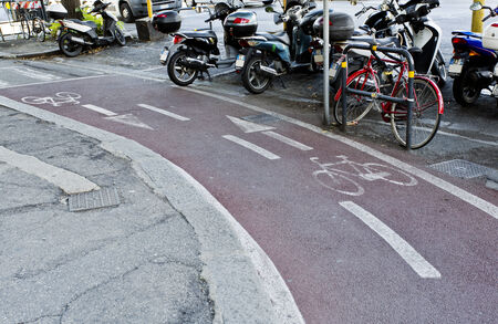 designated: A two way well designated pink bike lane for increased traffic safety.