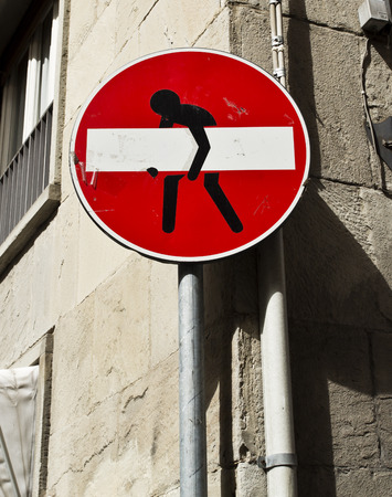 squeeze shape: A funny No Entry Sign on a street in Florence, Italy