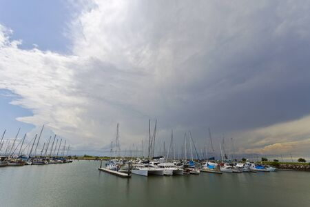 Storm approaching over the marina at Scarborough, Queensland, Australia photo