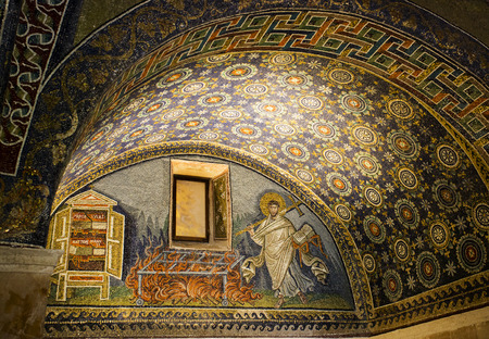 pyre: Detail of a Byzantine mosaic depicting St. Lawrence carrying the book of Psalms and a cross in the Mausoleum of Galla Placidia, in Ravenna, Italy.