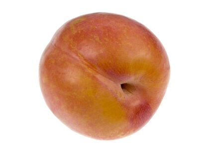 groove: Aurora plums (prunus domestica) are a stone fruit with a groove running down on one side. They are sweet in taste and have yellow flesh. Stock Photo