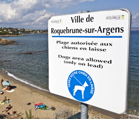 allowing: City council sign allowing dogs on lead on the beach below Editorial