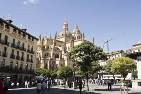 locals: Tourists and locals alike enjoying life in Plaza Mayor and the Gothic Cathedral of Segovia, Spain Editorial