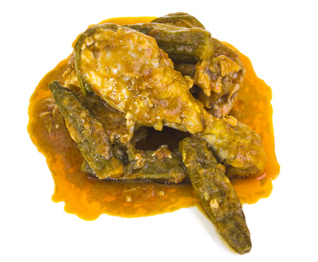 red palm oil: Moamba de galinha, also called Chicken Stew with Red Palm Oil, is a traditional dish from Angola in West Africa  made of chicken and okra cooked in red palm oil. Stock Photo