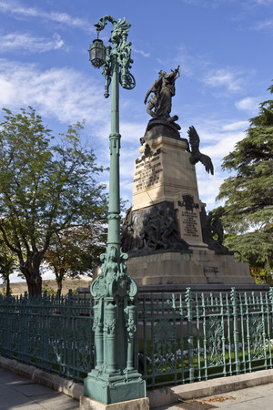 rebels: Lamppost in Square Queen Victoria Eugenia with the Monument to the 2nd of May Rebels on the background in Segovia, Spain Editorial