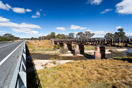 disrepair: New road bridge side by side with the old railway bridge over the Tenterfield Creek, Tenterfield, New South Wales, Australia,