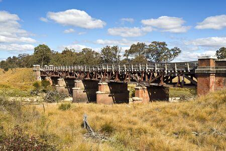 in disrepair: Sunnyside railway bridge over the Tenterfield Creek, Tenterfield, New South Wales, Australia, built from ironbark hardwood in 1888, has fallen into disrepair.