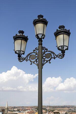pf: Triple lantern street lamp in front of the main facade pf the Alcazar of Toledo, Spain