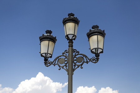 alcazar: Triple lantern street lamp in front of the main facade pf the Alcazar of Toledo, Spain