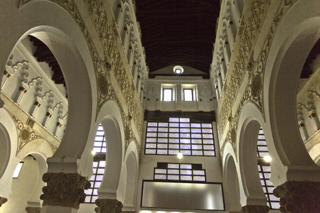 View under low light of the central aisle of the Synagogue Santa Maria la Blanca in Toledo Spain