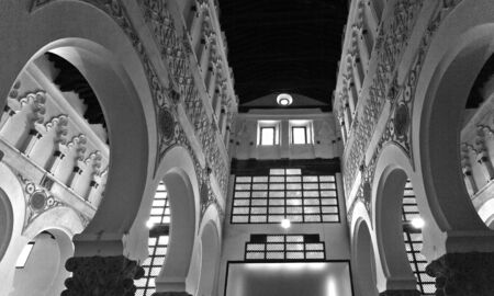 sephardi: View under low light of the central aisle of the Synagogue Santa Maria la Blanca in Toledo Spain