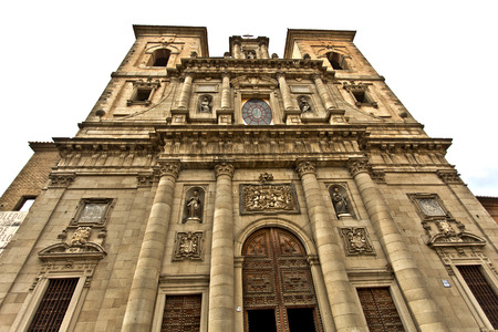 enormous: The facade of the Church of San Ildefonso with its large window and enormous Corinthian columns, in Toledo Spain Stock Photo