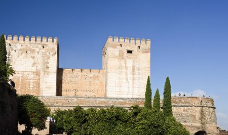 of homage: View of the Alcazaba with the Broken Tower left and the Tower of Homage center in The Alhambra complex, Granada, Spain