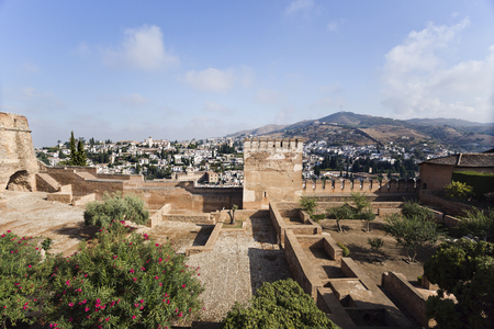 of homage: The Homage and Hens Towers with a view of the Albaicin district in the background, in The Alhambra, Granada, Spain