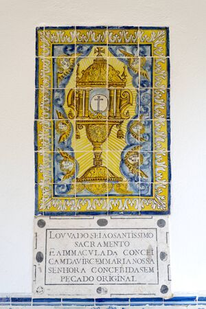 conde: Portuguese tiles panel of religious significance on the facade of the Chapel of Saint Sebastian in Cascais, Portugal Stock Photo