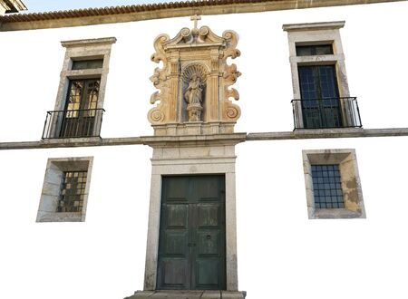surmounted: Top Entrance Door to the Monastery of Sao Martinho surmounted by the image of Our Lady of Pillar, in Tibaes, Portugal