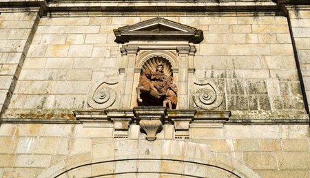 saint martin: Detail of the statue of Saint Martin placed above the door to the Church of the Monastery of Tibaes, Portugal