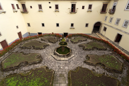 octagonal: View of Saint John Garden with its octagonal shape and eight flowerbedsat the Monastery of Sao Martinho in Tibaes, Portugal