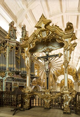 crucified: The baroque style Oratory of Christ Crucified in the church of the Monastery of Sao Martinho in Tibaes, Portugal Editorial
