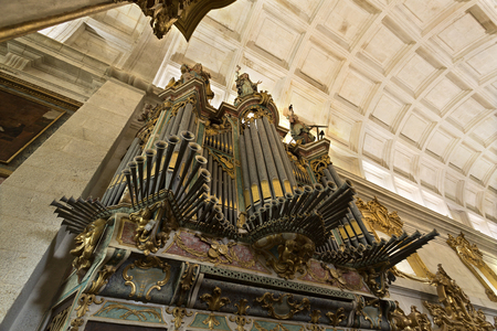 pipe organ: View of the eighteen century 1786 baroque style pipe organ in the Monastery of Sao Martinho in Tibaes, Portugal