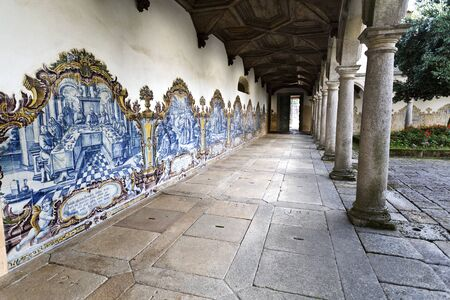 episodes: View of the Cemetery Cloister with its decorative panels of tiles in the Monastery of Sao Martinho in Tibaes, Portugal