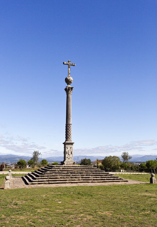 comprising: The Stone Cross of Tibaes is a Renaissance monument comprising a Corinthian column and capital with a sphere and a Latin cross on top. Stock Photo