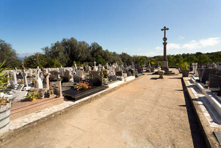 wider: Wider view of the cemetery and its Stone Cross adjacent to the Monastery of Tibaes, Portugal