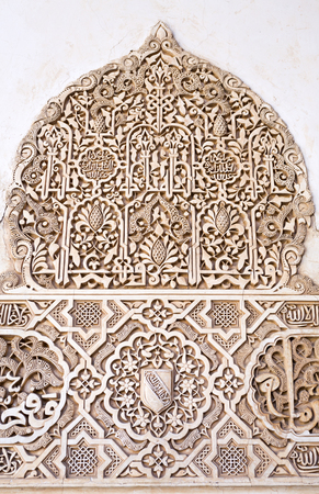 plasterwork: Detail of the decorative bas-relief on the walls of the north portico in the Court of the Myrtles, in The Alhambra, Granada, Spain Stock Photo
