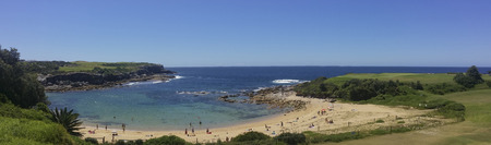 prevailing: Little Bay in NSW, Australia, is a beach semi-circular in shape and enclosed by headlands to the south and north. Its narrow entrance provides significant shelter from prevailing sea conditions. Stock Photo