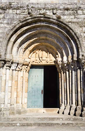 medievales: Portal of the 11th century Romanesque Church of Saint Peter of Rates, Povoa de Varzim, Portugal Foto de archivo